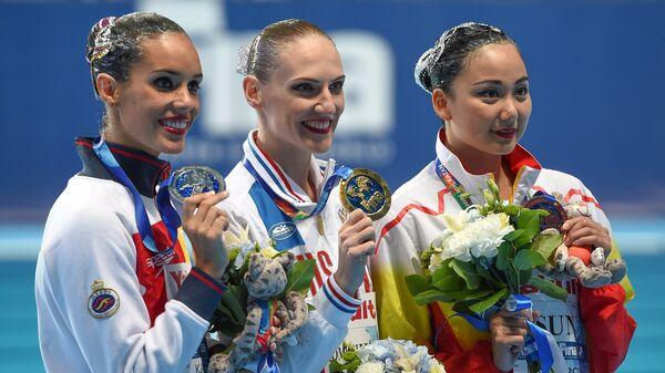 Она Карбонель, Светлана Ромашина и Сунь Вэньянь (слева направо)