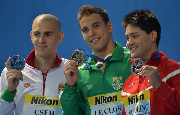 Ласло Чех (Венгрия), Чэд  ле Кло (ЮАР), Джозеф Исаак Скулинг (Сингапур) (слева направо)