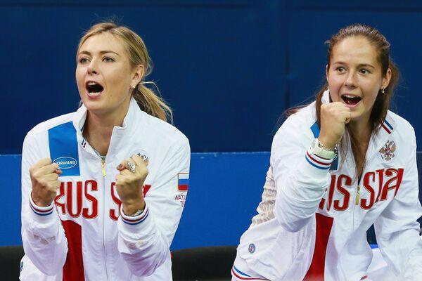 Мария Шарапова (слева) и Дарья Касаткина