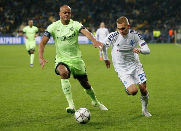 Защитник Манчестер Сити Венсан Компани и форвард киевского Динамо Виталий Буяльский (слева направо)