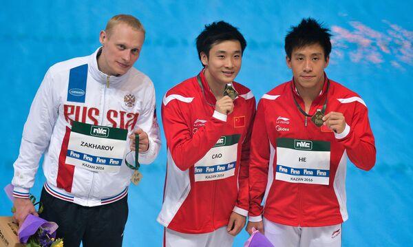 Илья Захаров (Россия) - 2-е место, Цао Юань (КНР) - 1-е место, Хэ Чао (КНР) - 3-е место (слева направо)