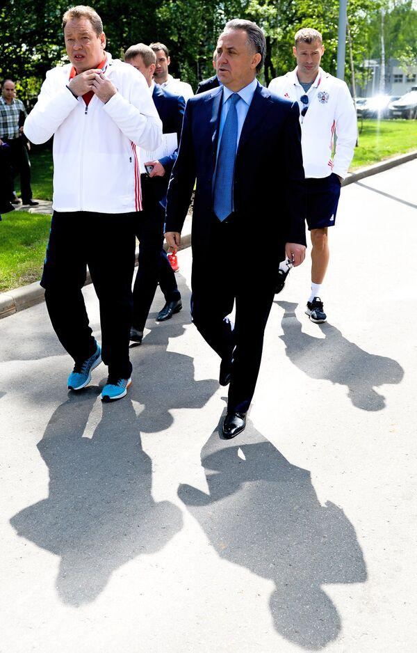 Леонид Слуцкий и Виталий Мутко (слева направо на первом плане)